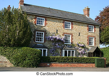 Stone cottage and Wisteria. - Stone cottage with Wisteria...