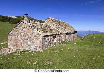 stone cottage in an idyllic landscape on a sunny day
