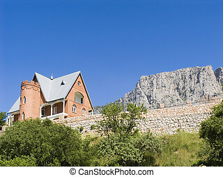 Stone cottage in mountains on a background of the dark blue...