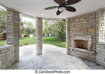 Stone covered patio in new construction home