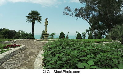 Stone cross in garden - In botanical park Batumi stone cross...
