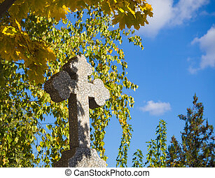 Stone cross in the cemetery. Quiet abode.