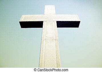 stone cross on sky background