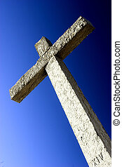 Stone Cross - Religious stone cross on a beautiful blue sky