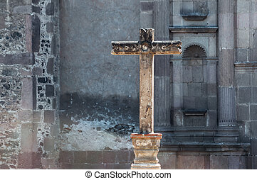 Stone Cross - Stone cross with a stone background in Mexico...
