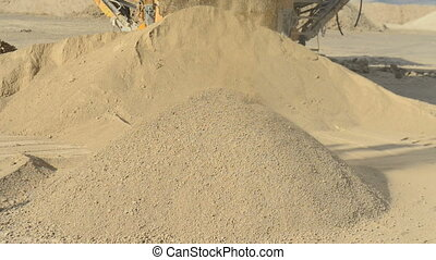 Stone crusher at the quarry - Detail shot sand stream out of...