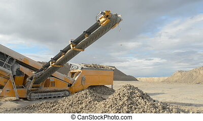 Stone crusher at the quarry - Mid shot of machine for...