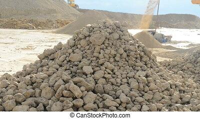 Stone crusher at the quarry - Detail shot of falling rocks...