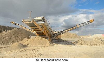 Stone crusher at the quarry - Establishing shot of machine...