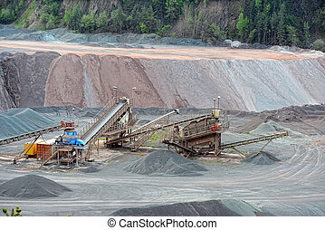 stone crusher in a quarry mine of porphyry rocks.