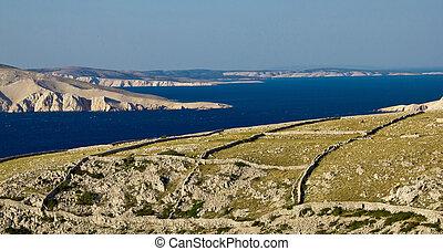 Stone desert landscape and sea