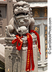Stone Dragon Red Ribbons Buddhist Sayings Jade Buddha Temple Jufo Si Shanghai China Most famous buddhist temple in Shanghai