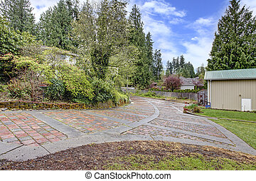 Stone driveway and garage - Front view of stone driveway and...