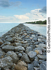 Stone embankment to prevent the waves of the sea.