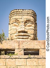 Stone face of a temple.