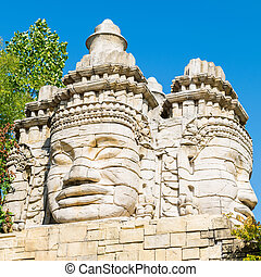 Stone faces of a temple.