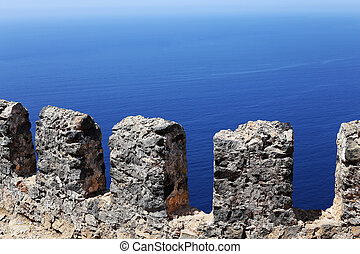 stone fence on a background of the sea