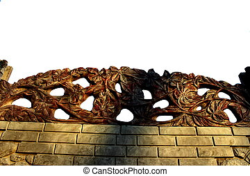 Stone fence with branches
