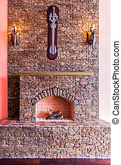 Stone fireplace with lamps