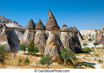 Stone formations in Cappadocia - Fairy chimneys (rock...