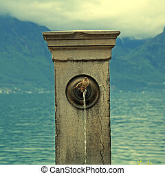 Stone fountain with bird, Lake Geneva