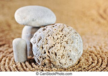 Stone garden - Sea pebble on wet sand in morning light