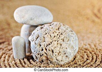 Stone garden - Sea pebble on wet sand in morning light