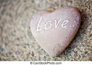 Stone heart with the word - Love - on it - Natural stone...