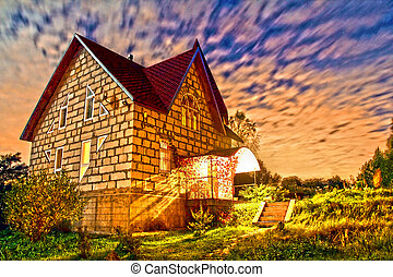 stone house at sunset