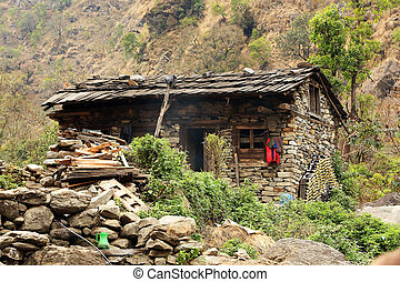 Stone house in the mountains of the Himalayas. Everest...