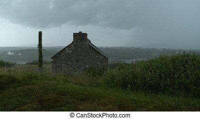 Stone Hut Overlooking Neighborhood - Steady, medium wide...
