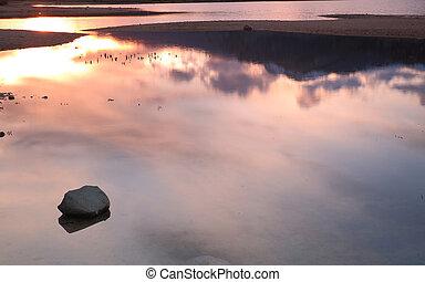 Stone in lake water