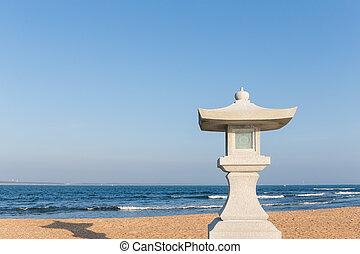Stone lantern in the beach