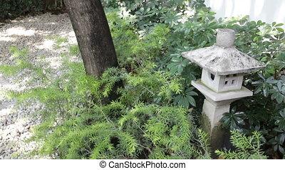 Stone lantern in zen garden, stock footage