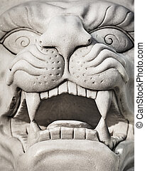 Stone lion head - marble statue - Stone lion head - a marble...