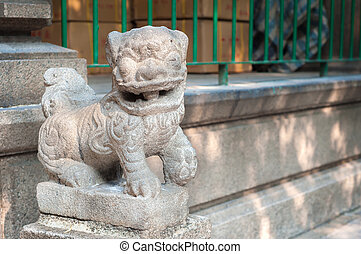 Stone lion outside Tin Hau Temple, Yaumatei, Kowloon