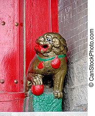 stone lions in front of the door