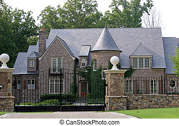 Stone Mansion - Stone mansion behind iron gate