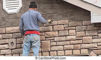Stone Mason 1 - Stone mason putting stone on new ...