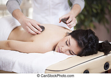 Stone massage at a health spa