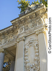 Stone monument with Ionic columns in the Jardin del Retiro...
