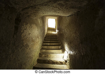 stone narrow passage with stairs leading