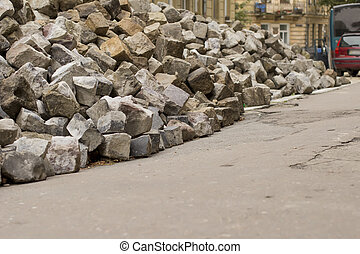 stone of grey blocks lying in the road