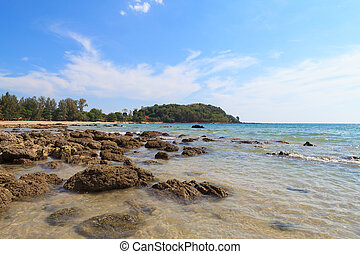 Stone on the beach with blue sky