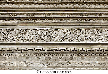 Stone ornament on wall of old temple. Indonesia, Bali Island