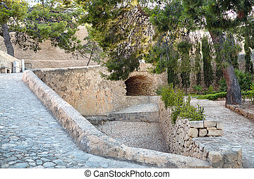 Stone passage of limestone under the bridge in the castle Santa Barbara, Alicante, Spain
