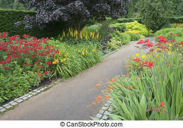 Stone path in blooming garden