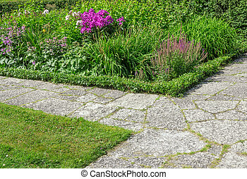 Stone paths in a flowering garden