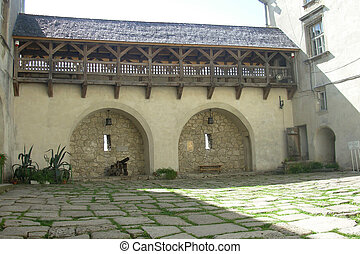 stone-paved courtyard of the old Ukrainian castle