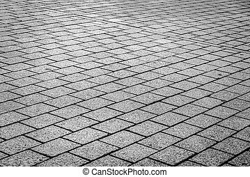 Stone paving texture. Abstract photo of stone city path.